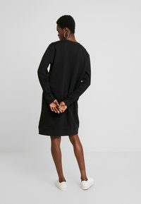 Calvin Klein Jeans - TAPING THROUGH MONOGRAM DRESS - Day dress - black - 3