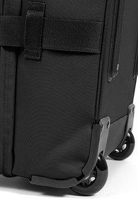 Eastpak - TRANVERZ M CORE COLORS - Wheeled suitcase - black - 7