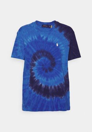 Triko spotiskem - blue ocean spiral