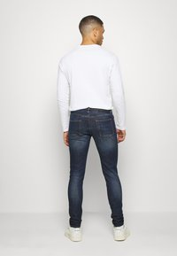 Diesel - D-STRUKT - Jean slim - dark-blue denim - 2