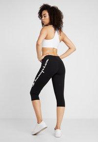 Champion - CAPRI PANTS - 3/4 sports trousers - black - 2