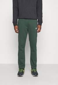 Nike Sportswear - CLUB PANT - Tracksuit bottoms - galactic jade/white - 0