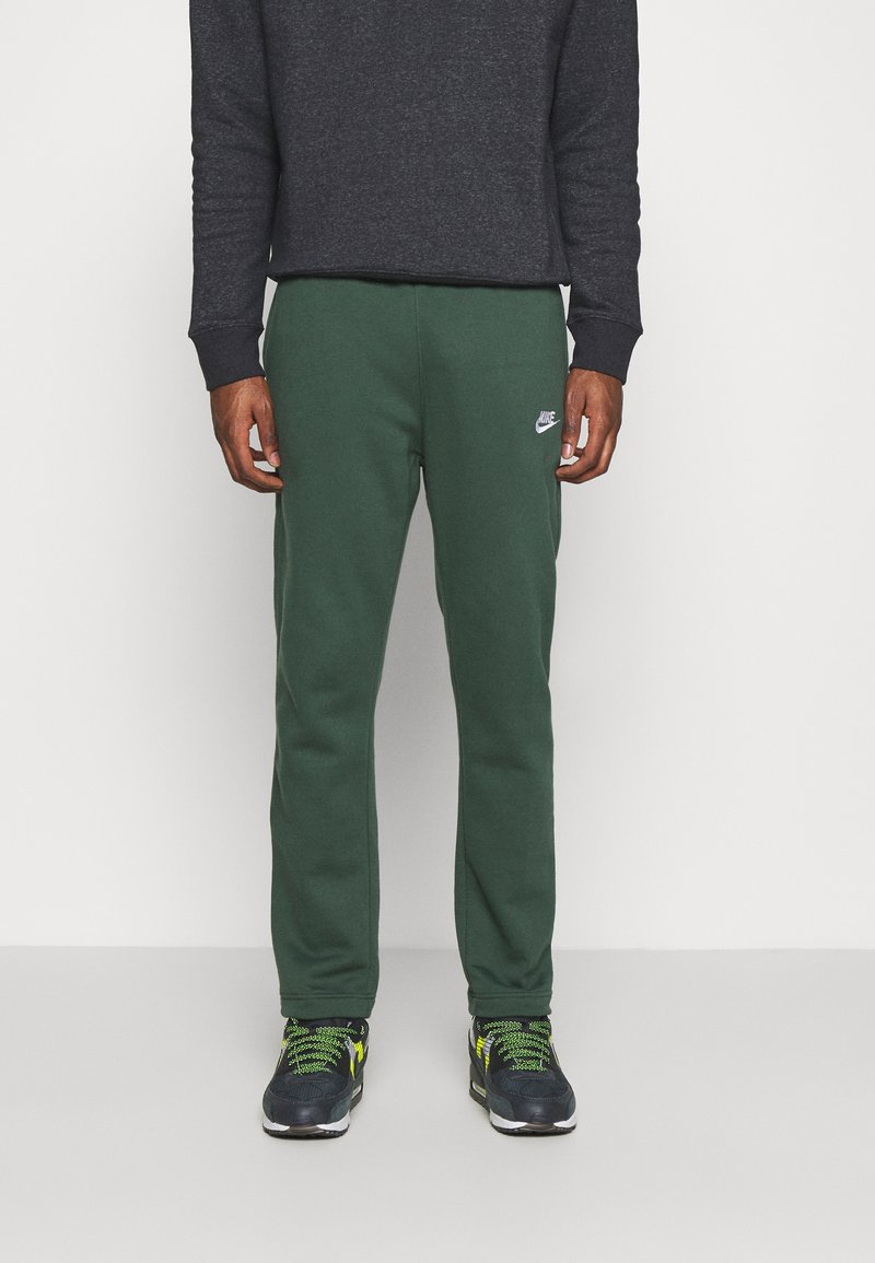 Nike Sportswear - CLUB PANT - Tracksuit bottoms - galactic jade/white