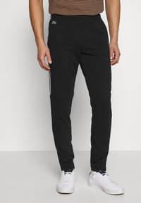Lacoste - Tracksuit bottoms - black/white - 0