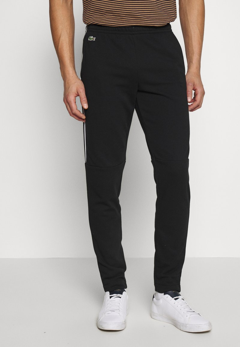 Lacoste - Tracksuit bottoms - black/white