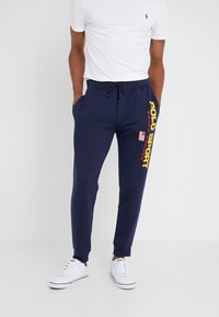 Polo Ralph Lauren - Tracksuit bottoms - cruise navy - 0