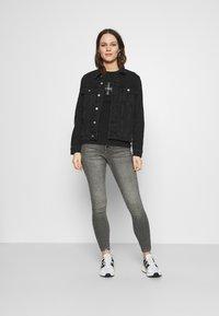 Calvin Klein Jeans - REFLECTIVE MONOGRAM TEE - Printtipaita - black - 1