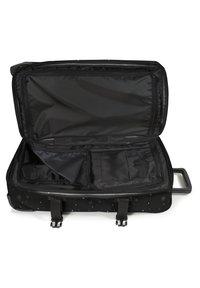 Eastpak - TRANVERZ - Wheeled suitcase - splashes dark - 3
