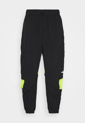 URBAN PANT - Spodnie treningowe - black/neon green