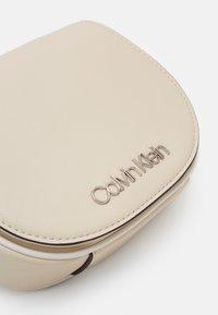 Calvin Klein - CHAIN BELT BAG - Bum bag - beige - 3