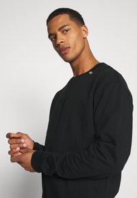 RETHINK Status - CREWNECK UNISEX - Sweatshirt - black - 3
