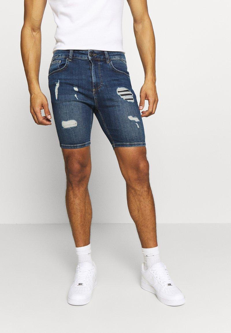 11 DEGREES - RIP AND REPAIR  - Denim shorts - mid blue