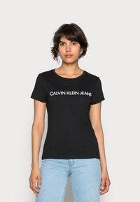 Calvin Klein Jeans - INSTITUTIONAL LOGO TEE - T-shirts print - black - 0