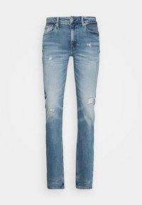 SLIM TAPER - Slim fit jeans - bright blue destroyed