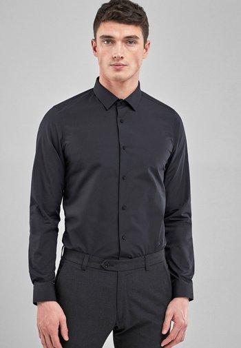 WHITE SKINNY FIT SINGLE CUFF EASY CARE SHIRT - Camicia - black