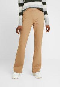 Modström - TANNY FLARE PANTS - Trousers - caramel - 0