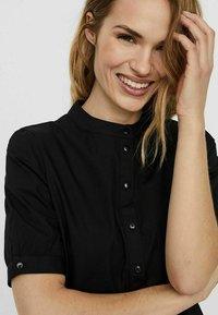 Vero Moda - STEHKRAGEN - Shirt dress - black - 3