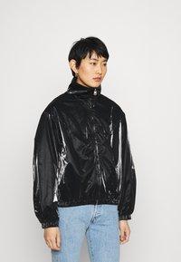 Calvin Klein Jeans - ZIP THROUGH - Windbreaker - black - 0