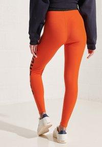 Superdry - Leggings - Trousers - bold orange - 1