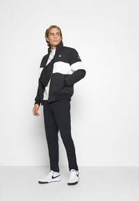 Calvin Klein Jeans - OUTLINE LOGO JACKET - Winter jacket - black - 1
