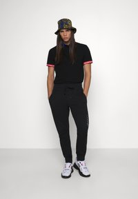 Versace Jeans Couture - Polo shirt - nero - 1