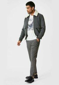 C&A - Trousers - black / grey - 1