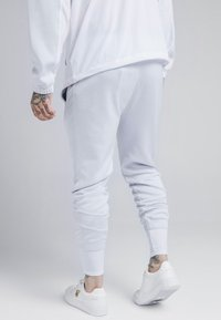 SIKSILK - TRANQUIL DUAL CUFF PANTS - Verryttelyhousut - light blue/white - 2
