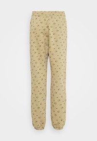 Nike Sportswear - W NSW PANT BB AOP PRNT PACK - Tracksuit bottoms - parachute beige - 7