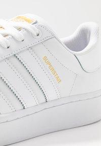 adidas Originals - SUPERSTAR BOLD - Trainers - footwear white/gold metallic - 2