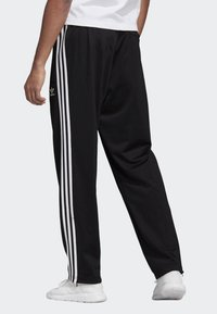 adidas Originals - FIREBIRD ADICOLOR TRACK PANTS - Tracksuit bottoms - black - 1