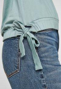 s.Oliver - À NŒUDS DÉCORATIFS - Long sleeved top - light green - 6