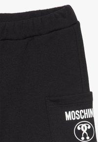MOSCHINO - Teplákové kalhoty - black - 2