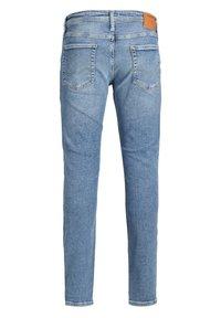 Jack & Jones Junior - Slim fit jeans - blue denim - 4