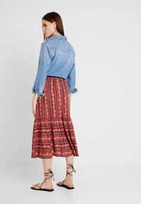 Louche - TIMO FOLKSTRIPE - A-line skirt - red - 2