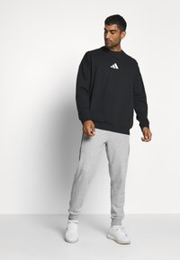 adidas Performance - TIGER CREW - Sweatshirt - black - 1