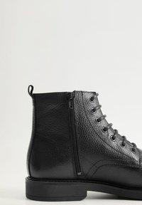 Mango - Lace-up ankle boots - black - 6
