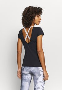 Nike Performance - THE YOGA LUXE - T-shirts - black/dark smoke grey - 2