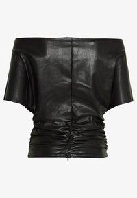 NA-KD - HANNA  SCHÖNBERG X NA-KD ONE SHOULDER - Bluse - black - 1