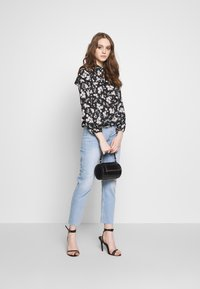 Noisy May - NMJENNA - Jeans relaxed fit - light blue denim