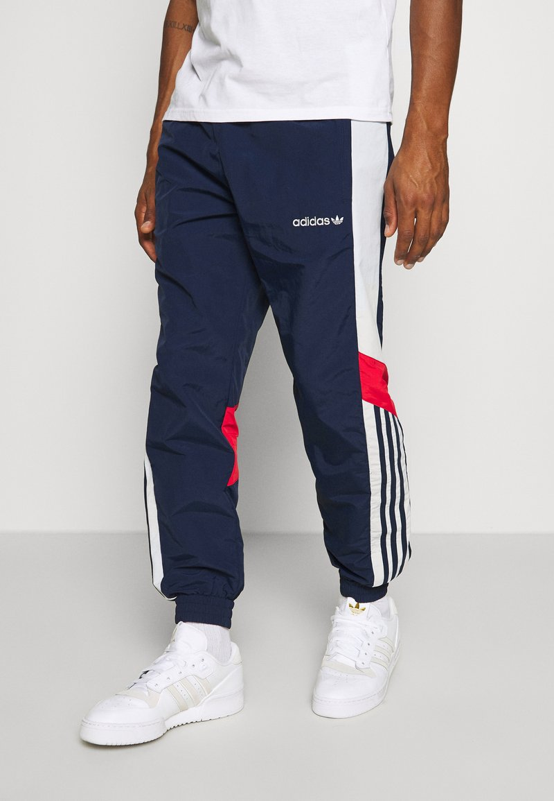 adidas Originals - TRACKPANT - Tracksuit bottoms - navy/grey/red