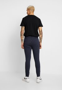 CLOSURE London - PIN STRIPE - Trainingsbroek - navy - 2