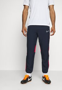 Nike Performance - DRY ACADEMY PANT - Tracksuit bottoms - obsidian/university red/white - 0