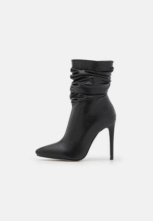 BELLO - Nilkkurit - black