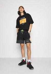 Jordan - Shorts - black/smoke grey/citron pulse/electric green - 1