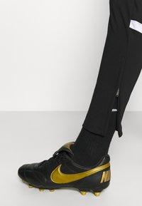 Nike Performance - PANT - Pantalon de survêtement - black/white - 3
