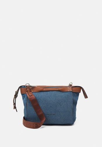 STACHEL - Handbag - blue denim