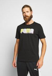 Puma - CELEBRATION GRAPHIC TEE - T-shirt imprimé - black - 0