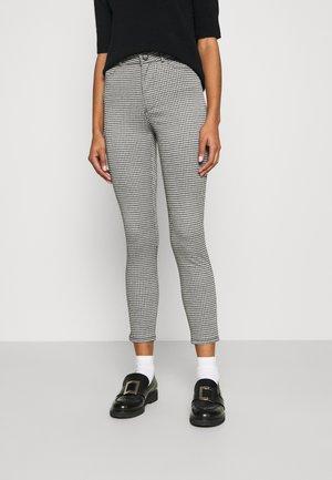 CIRCULAR CUADROS - Trousers - black