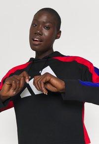 adidas Performance - BIG LOGO - Tuta - black/vivid red/bold blue - 5