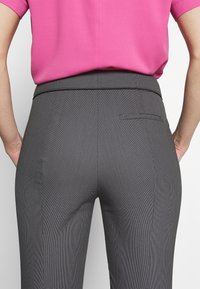 HUGO - THE CROPPED TROUSERS - Trousers - black - 6